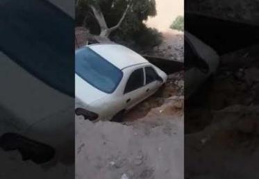 انهيار أرضي مفاجئ يبتلع السيارات في مصر